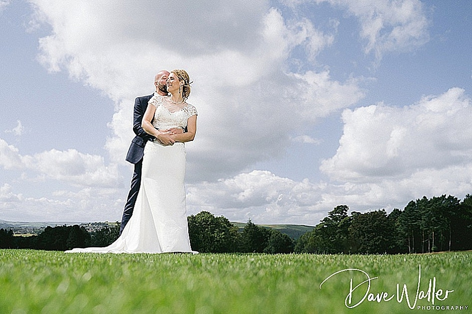 bride and groom out side at Aldwark Manor