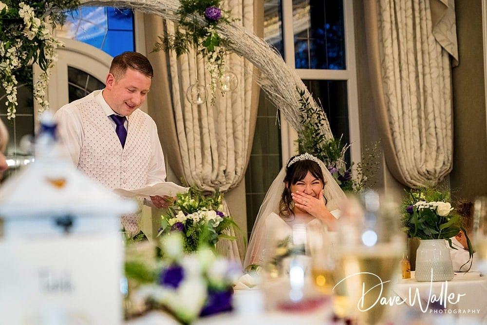 bride and groom at Aldwark Manor speeches