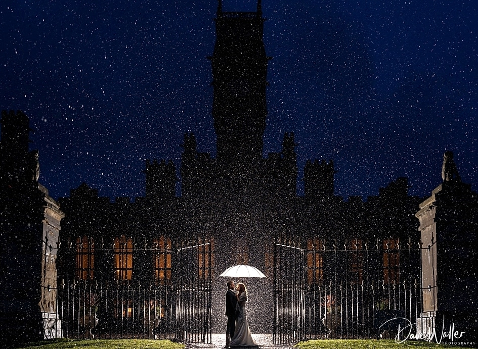 bride and groom at Carlton towers on their wedding day in the rain