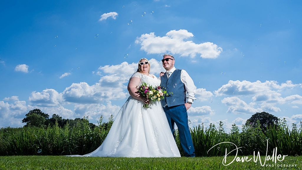 bride and groom in the sunshine at Sandhole Oak Barn