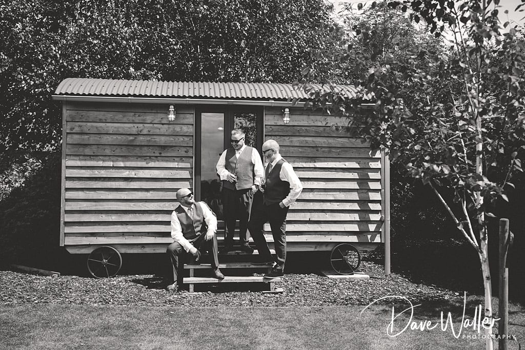 grooms man at the Shepards hut at Sandhole oak barn on their wedding day