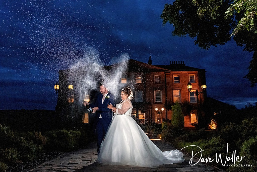 Champaign spray by the bride and good at Waterton Park West Yorkshire